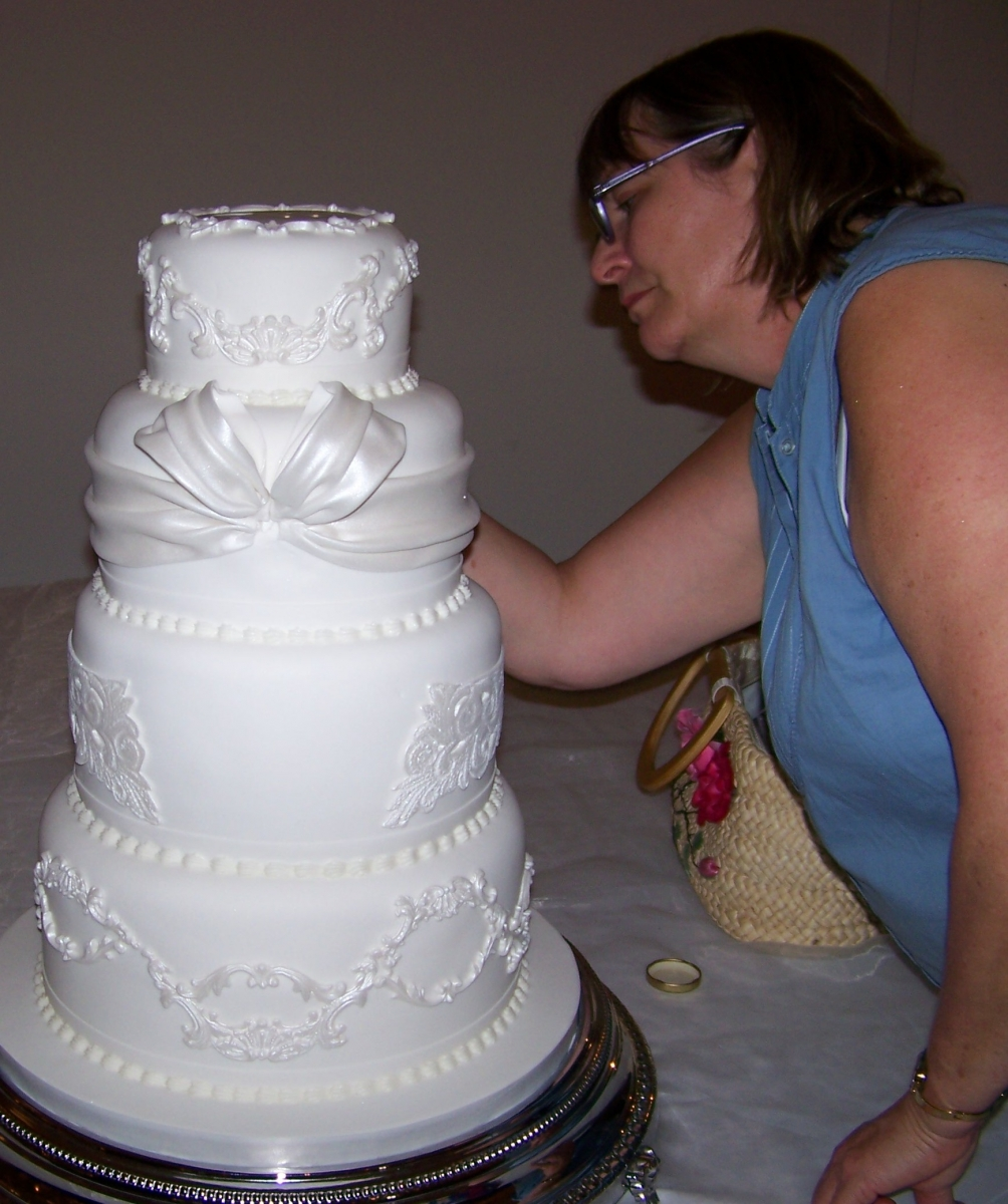 Gina Perry finishing touches on Wedding Cake Delicery